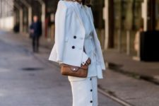 22 all-white look with a button down skirt and tan heels and bag