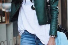 22 green leather jacket, a white top and jeans