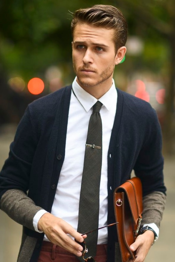 red pants, a white shirt, a navy cardigan and a grey tie