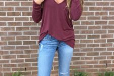22 ripped blue jeans, a burgundy shirt and brown fringe boots