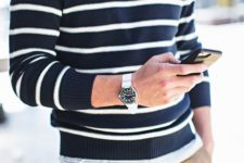 22 striped sweater, khaki joggers, silver watch, aviator sunglasses