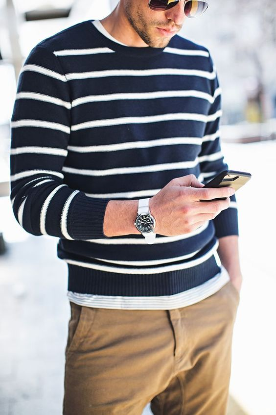 striped sweater, khaki joggers, silver watch, aviator sunglasses