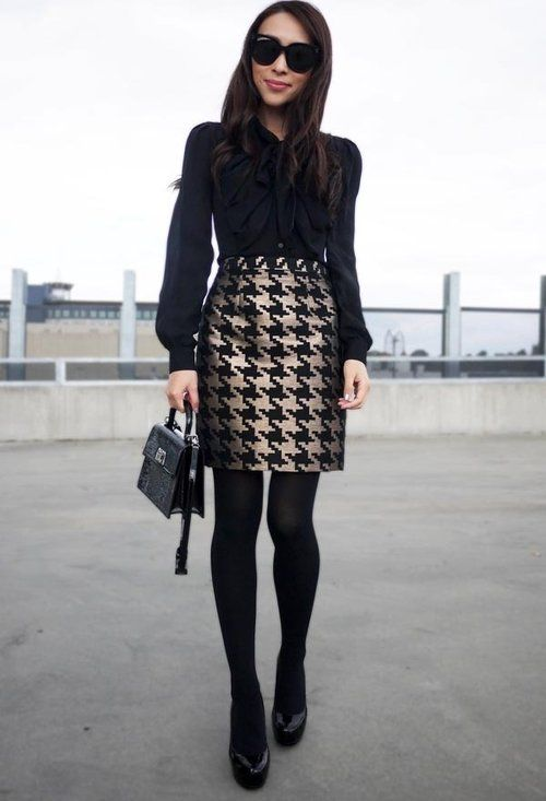 an all-black look with a patterned skirt