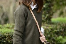 23 green sweater, a white button down, a mini tweed skirt