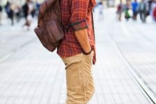 23 ocher pants, a plaid shirt and red Converse
