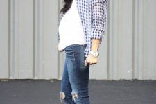 23 ripped jeans, a white top, a checked shirt and ankle boots