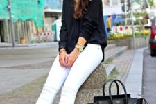 23 white jeans, a black shirt and black Converse