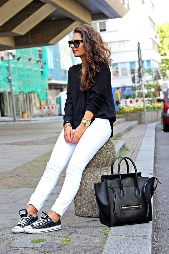 white jeans, a black shirt and black Converse