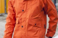 24 brown pants, a plaid shirt and an orange rain jacket