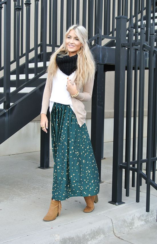 dotted jade green maxi skirt, a white top, a nude cardigan and a black scarf