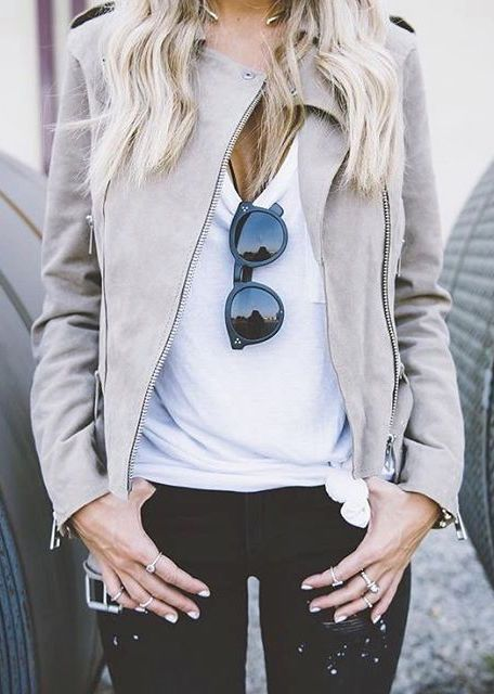 grey leather jacket, black jeans, a white tee