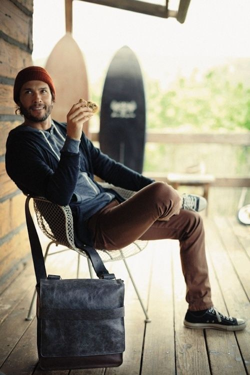 ocher trousers, a navy sweatshirt and a red beanie