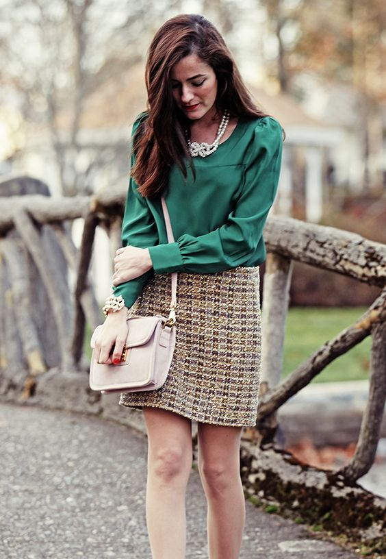 tweed skirt, an emerald blouse and a blush bag