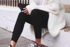 25 black leggings, a white tee, an oversized knit cardigan