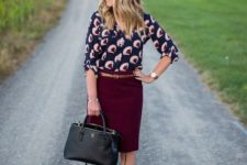 25 burgundy pencil skirt, a printed shirt and nude heels