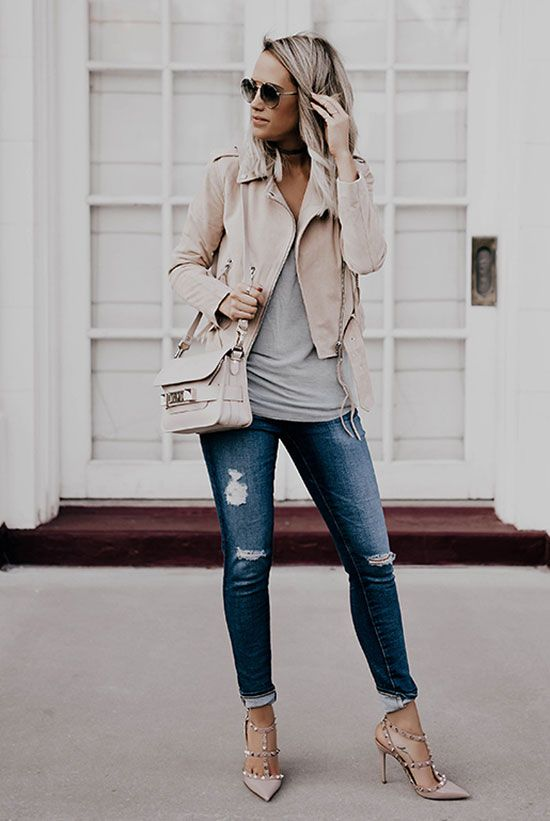 nude leather jacket, blue jeans and a grey t-shirt