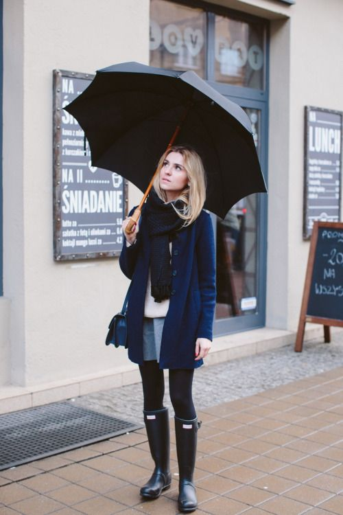 oversized navy cardigan, a skater skirt and hunter boots