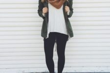 26 black leggings, a white t-shit, an love green jacket and white sneakers