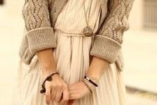 27 a white pleated dress, a grey cardigan and black tights