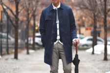 27 grey pants, a navy rain coat and red boots
