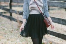 27 oversized grey cardigan, a striped tee, a pleated black skirt, tights and burgundy boots
