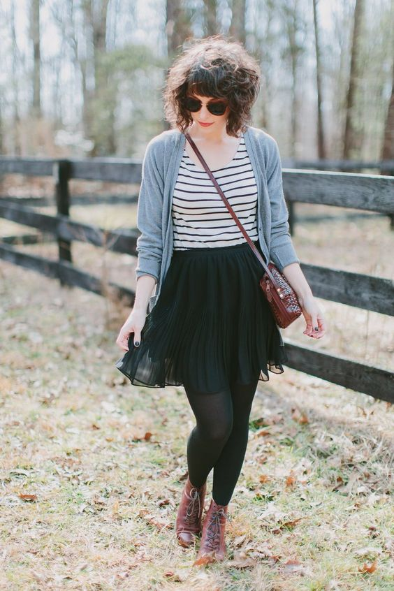 oversized grey cardigan, a striped tee, a pleated black skirt, tights and burgundy boots