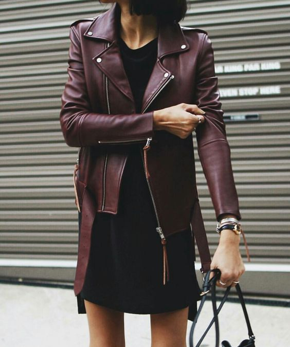 oxblood jacket and a black mini dress