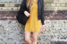28 black pilot jacket, golden yellow lace dress, faux suede backpack & heeled ankle boots