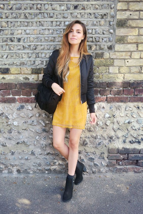 black pilot jacket, golden yellow lace dress, faux suede backpack & heeled ankle boots