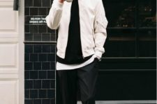 28 layered look with black pants, a white bomber jacket,a black sweater and grey chucks