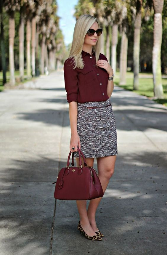 neutral printed skirt, a burgundy blouse and bag, leopard flats