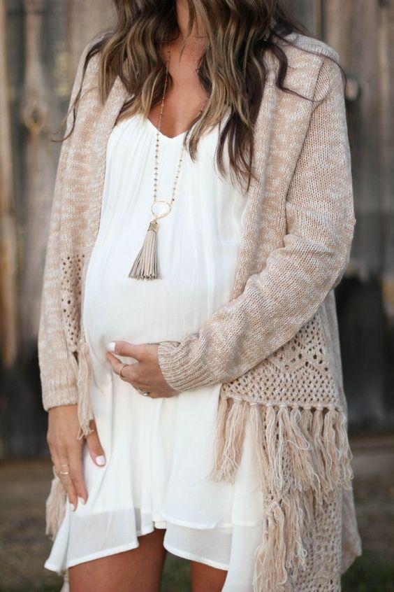 ruffled white dress, a comfy beige poncho with fringe