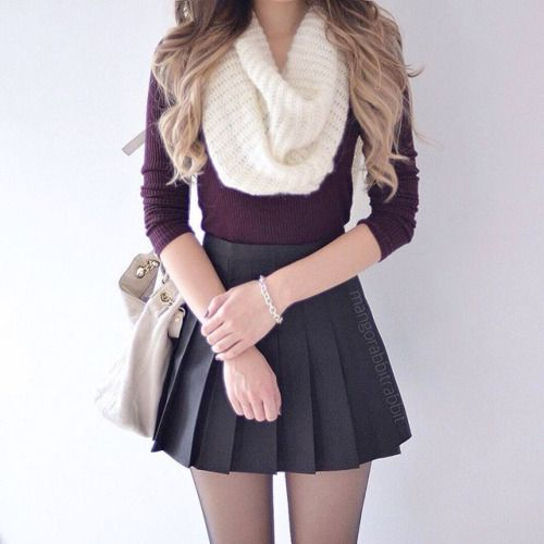 black pleated skirt, a burgundy shirt, a white scarf