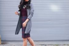 29 plaid skirt, a burgundy turtleneck, a statement necklace, a long grey cardigan and heels
