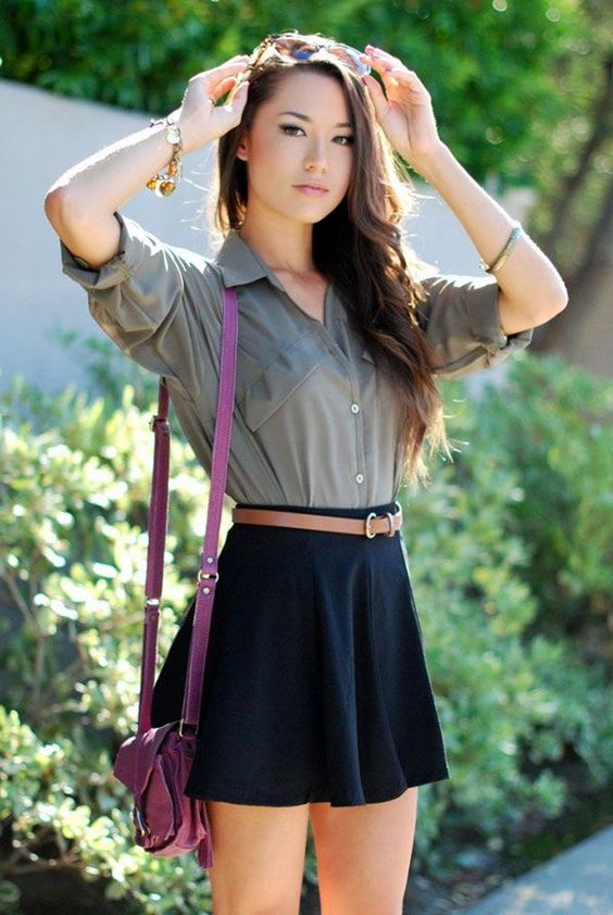 black skater skirt, a grey shirt and a bold pink purse