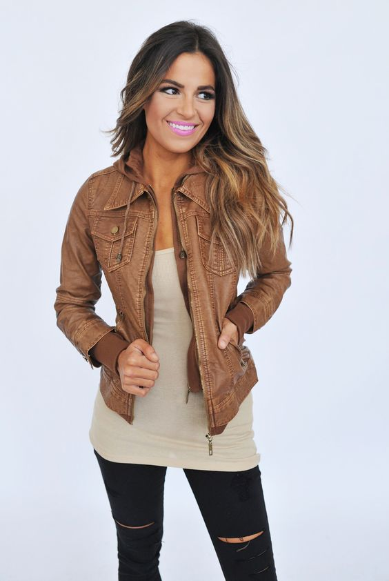 zippered brown leather jacket, ripped black jeans and a nude top