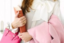 31 black trousers, a white bow blouse and a pink coat