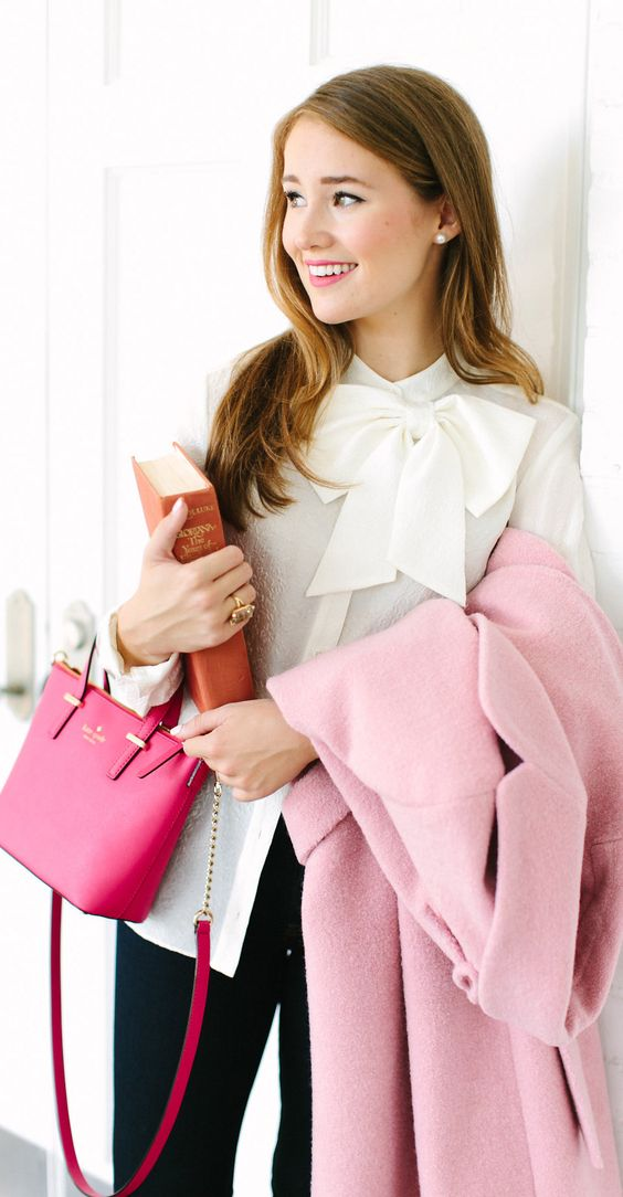black trousers, a white bow blouse and a pink coat