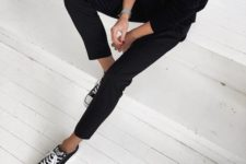 31 minimal all-black look with black trousers and a black sweater