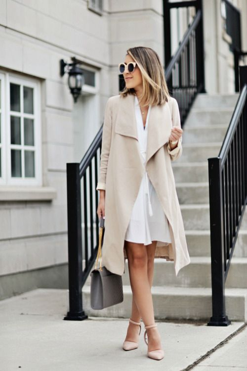 white dress, a nude trench coat and heels