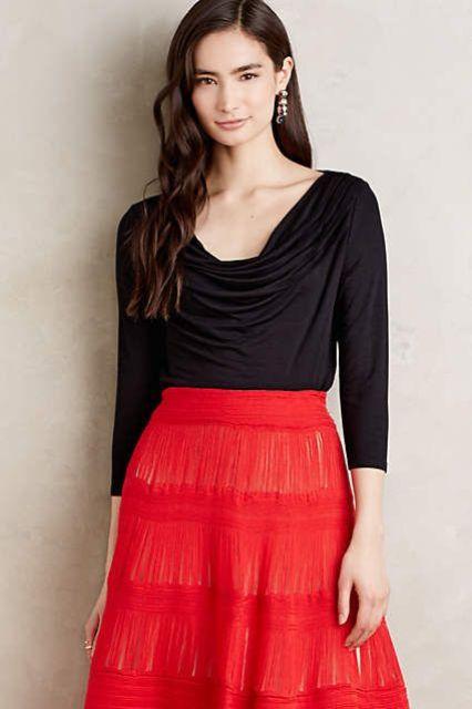 Black shirt with red fringe skirt