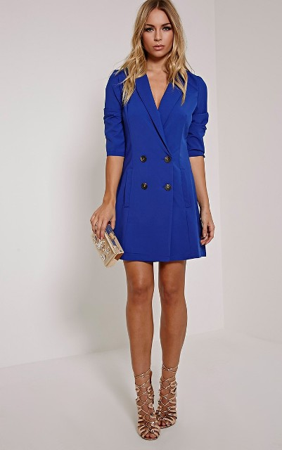 Blue dress with golden lace up heels and clutch