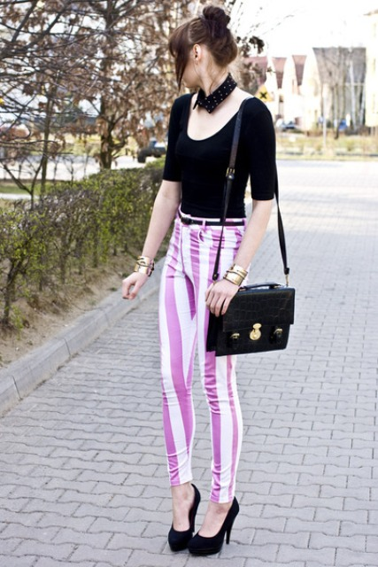 Colorful pants with black shirt shoes and accessories
