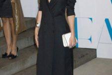 Elegant maxi dress with white clutch