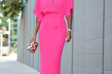 Eye-catching pink maxi dress with clutch