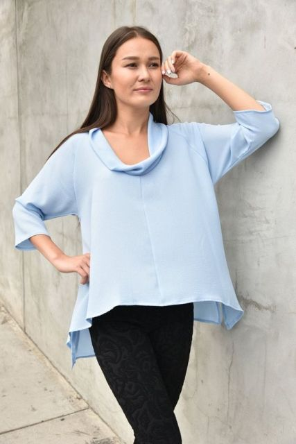 Loose light blue blouse with skinny pants