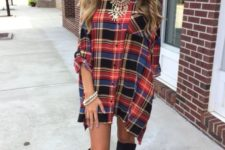 Loose mini dress with statement necklace and high boots