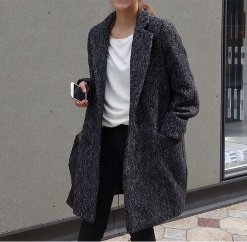 Oversized coat with simple white shirt and black trousers
