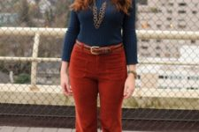 Retro styled look with flared corduroy pants, dark blue turtleneck and printed boots