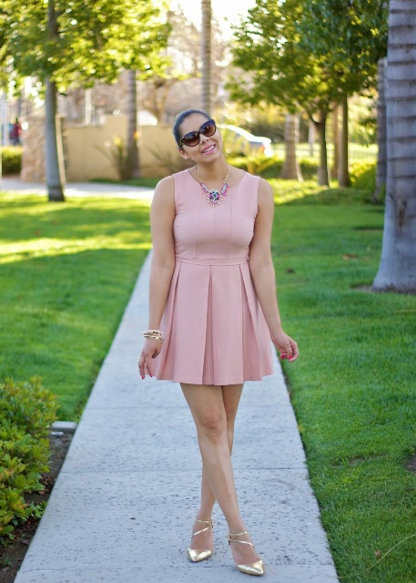 Skater dress with gold shoes and statement necklace